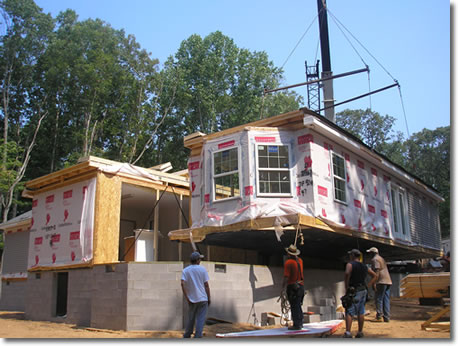 Shores Construction setting modular home on foundation